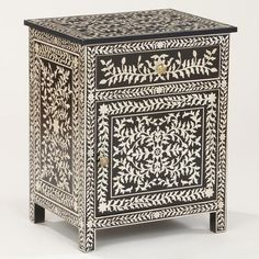 Inspired by the inlay work of the Taj Mahal, our Kiran Faux Inlay Cabinet is rich with character and versatility. Crafted of mango wood and featuring a black-and-white, hand-stenciled design, this World Market exclusive piece can be used as a side table, nightstand, telephone table or small cabinet.