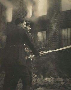 Firefighters in action in Redfern,in inner Sydney.     •Harold Cazneaux•
