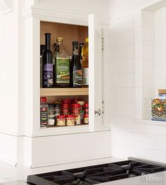 Spice jars and oil bottles perfectly suit cabinets with shallow shelves