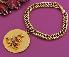 "Christmas Tree Charm Bracelet with Rhinestones  $30.00  Vintage Goldtone  Christmas Tree with Rhinestones  Charm Bracelet  Bracelet measures 7"""