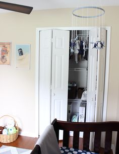 Lincoln's Blue and Gray Nursery Reveal via @MelissaCreates ....we spy Little O in the toy basket!