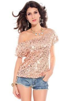 Bluza cu paiete aurii, cu dublura din material elastic de culoare roz. Bluza are maneci scurte si decolteu barca, putand fi lasata pe un umar. Bluza este de efect, putand fi purtata cu succes ca bluza de club/bluza de petrecere