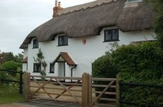 The Pros and Cons of Whimsical Cob Cottage Houses; Building a Debt Free Home!