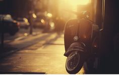 Photo Vespa in Golden Rays by Evgeny Tchebotarev on