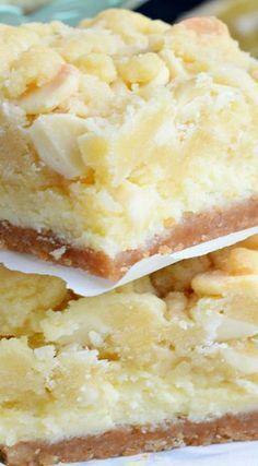 Cheesecake Bars ~ Layers of cookie crust, lemon cheesecake and lemon cookie bars. One of the most delicious desserts everLemon Cheesecake Bars ~ Layers of cookie crust, lemon cheesecake and lemon cookie bars. One of the most delicious desserts ever Lemon Desserts, Köstliche Desserts, Lemon Recipes, Sweet Recipes, Baking Recipes, Delicious Desserts, Yummy Food, Bar Recipes, Recipies