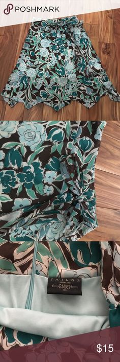 Tailor B. Moss skirt--flows and flirty.  Size 6. Fun skirt from B. Moss.  Cute tie detail at the waist.  Lined--no slip necessary!  Size 6.  Excellent used condition. Tailor B. Moss Skirts A-Line or Full