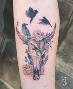 Single needle bull skull with a robin standing on its horn tattoo on Lindsay's left inner forearm. Tattoo Artist: Dino Nemec