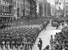 """In brazen contravention of the Treaty of Versailles, German armed forces re-entered the Rhineland on the 7th of March, 1936. Drawn up in 1919 after the First World War, the treaty stated that Germany was """"forbidden to maintain or construct any fortification either on the left bank or the right bank to the west of a line drawn fifty kilometres to the East of the Rhine."""""""
