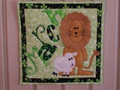 """March - Inspired by the patterns from @Count On It"""" by Nancy Halvorsen. Basic design and lettering are Nancy's but I added the lion and lamb. It is a hanging for my Mom's door in her assisted living residence."""