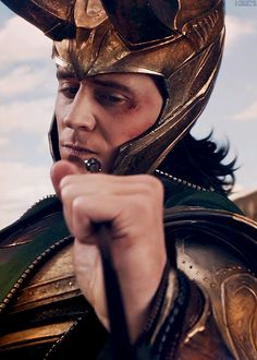 Loki (seriously, one of my favorite minutes of the the movie....the look on his face, the fact that it was beyond funny for Hawkeye due it being an exploding arrow is fabulous!)