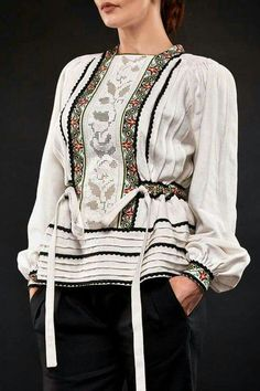 Beautiful oriental style top with crochet work on top of a black pant will  give you a chic look! e1f314376bc03