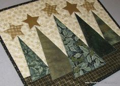 each tree different fabric and a different stitch pattern to ornate it with. not sure about the star.