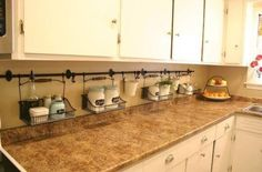 Use a shower curtain rod under the cabinets to create more counter space. Interesting option.