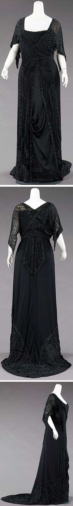 """Mourning  evening dress, Charlotte Duclos, Paris, ca. 1910. Silk and jet. Metropolitan Museum of Art: """"The elaborate but subtle beading on this mourning dress would have shimmered when new. The asymmetry of the charmeuse panel is indicative of the high fashion of the period. An example of extremely chic mourning attire for the evening, it features an element of subtle exposure: the beaded underpanel hidden by the charmeuse would have been revealed with the movement of the wearer."""""""