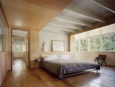 Minimally decorated wood and white bedroom.