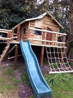 Our wonky treehouse looks like a cottage in a a fairy tale! Our client loved the idea of creating a crooked roof and door. The design is complete with a climbing net, slide and balcony.