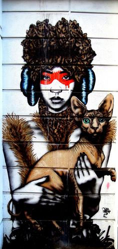 Tribal woman holding a sphynx cat - Photographed on Redchurch Street, Shoreditch, East London (June 2013)