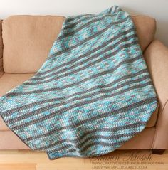 Crafty Chic's: School Spirit Crocheted Blanket - A mix of a variegated yarn and a solid contrast give this blanket so much visual interest