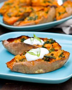 LOADED SWEET POTATO SKINS WITH KALE   What You Need  4 to 6 medium sweet potatoes (about 2 pounds – make sure they are all around the same size)  1 shallot  About half a bunch kale (enough for 2 cups kale)  1 cup chickpeas (canned or cooked)  1 cup shredded cheese (we used a Mexican blend of Monterrey jack and cheddar)  3/4 teaspoon kosher salt  Fresh ground pepper  Olive oil  Sour cream and green onions, to garnish