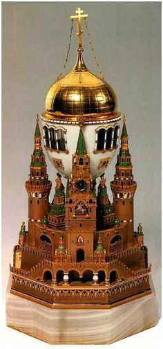 The 'Moscow Kremlin' Faberge Egg, made in 1906. Gift from Nicholas to his wife.  It is the largest of the Faberge eggs.  The top removes to reveal a remarkable miniature of the Cathedral of Assumption ~ where all the Tsars of Russia were crowned.  It is one of the few eggs that have never left Russia.