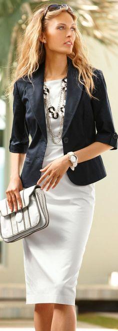 Modest dress, black blazer, cute clutch and a great statement necklace