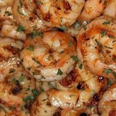 Ruth's Chris New Orleans-Style BBQ Shrimp 20 large (16/20) shrimp, peeled and deveined -1 ounce canola oil -1 tablespoon plus 5 teaspoons green onions, chopped -2 ounces dry white wine -1 teaspoon fresh chopped garlic -4 tablespoons Lea & Perrins Worcestershire Sauce -1 teaspoon Tabasco -1/2 teaspoon cayenne -1/2 teaspoon paprika -8 ounces (2 sticks) salted butter