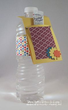 Decorate Water Bottles with Scrapbook Paper! Water Bottle Crafts, Water Bottle Gift, Fundraising Crafts, Plastic Bottle Flowers, Recycled Art Projects, Decorated Water Bottles, Summer Events, Scrapbook Paper Crafts, Paper Gifts