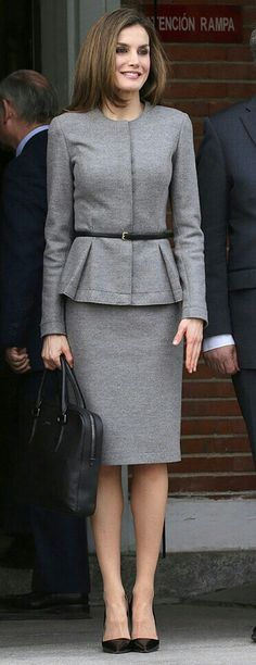 Queen Letizia - Carolina Herrera. grey cashmere skirt suit - Hugo Boss briefcase - Prada pumps