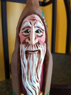 Sweet little Old World Santa in suede and burgundy. Hand-carved by Elizabeth Brown.