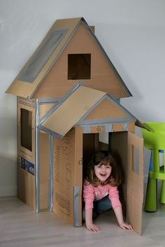 playhouse made out of cardboard boxes.: