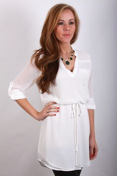 Wear with black leather leggings in winter or colorful skinnies in spring #page6boutique The Emery Tunic in White, $49.99