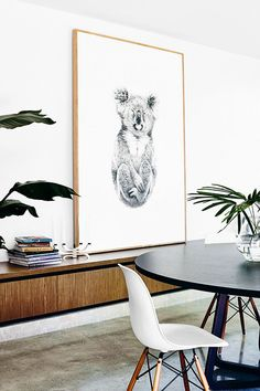 Modern dining space with large black and white art