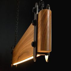 Our industrial linear wood beam LED pendant light is an old-worldly composition of timber and steel contrasted with the clean modern look of embedded LED strip lighting. Linear Lighting, Lighting Design, Club Lighting, Vintage Industrial Lighting, Rustic Industrial, Led Pendant Lights, Pendant Lamps, Wood Beams, Vintage Wood