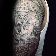 Guy With Stone Mayan Themed Half Sleeve Tattoo