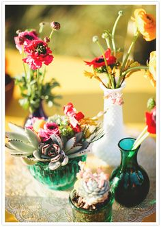 summery florals in mismatched vintage bottles and vases used as wedding centerpieces