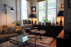Love the furniture/ wall mounted lamps for space (good if have dogs, too) Jenia & Sergey's Victorian Row House