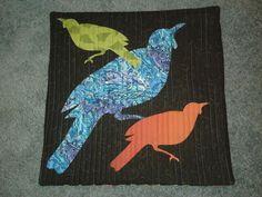 Cushion covers with New Zealand  birds. Jenny  Hunter design.