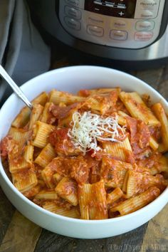 Easy Instant Pot pizza pasta recipe that my family loves! Super easy to throw together and make in your pressure cooker in just minutes.