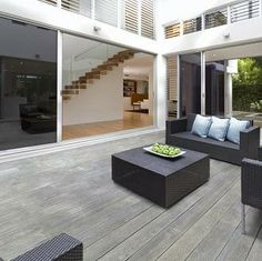 Pale smoked composite decking boards looking sleek and stylish on this contemporary deck.