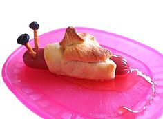 Snail snack, GREAT for a kid's bug-themed birthday party! (hotdog in a crescent roll, with pretzel sticks and raisins for eyes!)