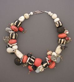 "Necklace | Anna Holland. selection of beads, including striped bone beads, old Tibetan chank shell, Czech wedding beads, lava beads, ""coral"" glass beads, whitehearts, and Picasso jasper beads"