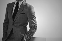 He's tall, dressed in a fine gray suit, white shirt, and black tie. #fiftyshades