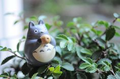 Totoro playing ocarina in a terrarium. Probably the cutest thing you've seen all day. And you can make one yourself.
