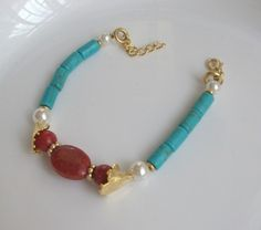 Coral and Turquoise are dancing in Gold Bracelet