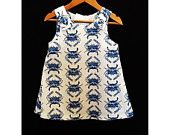Crabby girl's dress with covered buttons