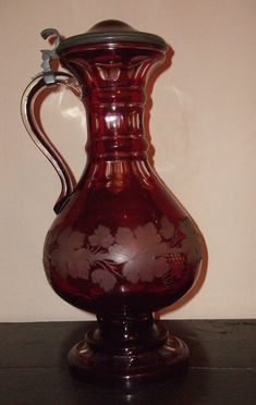 I love Ruby Glass. I have several pieces from my grandparents.  Bohemian Ruby Glass Flagon
