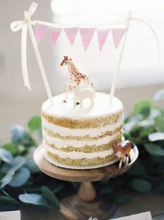 Accessorize desserts with fun plastic animals: http://www.stylemepretty.com/living/2015/08/09/25-ingenious-baby-shower-ideas/