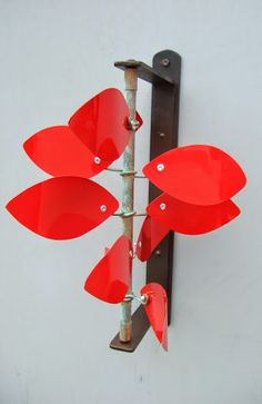 Copper and aluminum wind sculpture. Mounts to a wall, post, fence or any vertical surface. Spins in the wind. Free shipping !