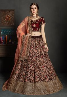 Designer Maroon Color Pure Velvet Heavy Embroidered Bridal Wear Lehenga Descripiton : Round out your ethnic closet staples with this fashion forward maroon color wedding bridal lehenga choli. Crafted of pure velvet lehenga and choli, this lehenga Bridal Lehenga Online, Wedding Sarees Online, Designer Bridal Lehenga, Lehenga Choli Online, Bridal Lehenga Choli, Indian Lehenga, Lehenga Saree, Ghagra Choli, Anarkali Suits