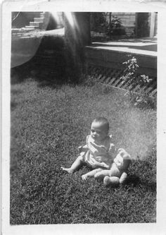Black and White Vintage Snapshot Photograph Baby Girl Weird Toy Yard 1950's